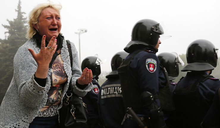 A woman reacts outside trade union building, where deadly fire occurred, during a rally in Odessa