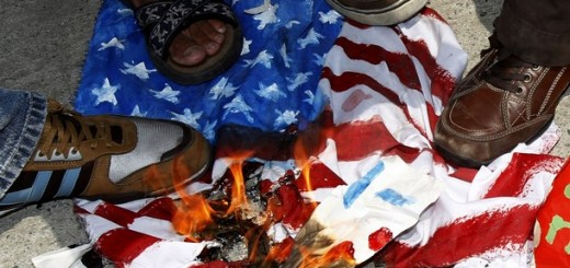Students step on burning replica of US flag during a protest in Manila