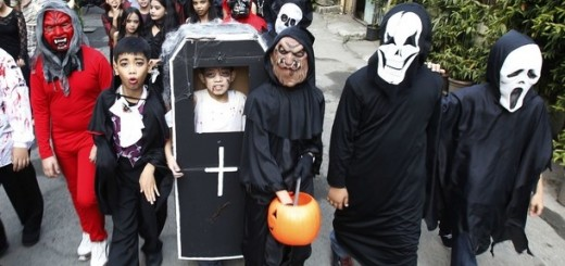 Students from the Brainshire Science School dress in Halloween costumes as they parade along the main street of Paranaque