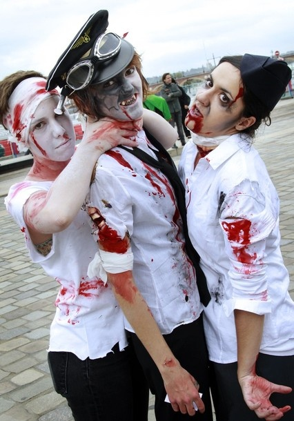 People take part in a Zombie Walk event